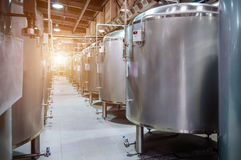 Modern Beer Factory. Small steel tanks for fermentation of beer. Modern Beer Factory. Small steel tanks for storage and fermentation of beer. Sunlight effect Stock Photo