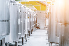 Modern Beer Factory. Small steel tanks for fermentation of beer. Modern Beer Factory. Steel tanks for storage and fermentation of beer. Sunlight effect Stock Images