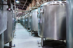 Modern Beer Factory. Small steel tanks for fermentation of beer. Modern Beer Factory. Small steel tanks for storage and fermentation of beer. Toned image Stock Photography