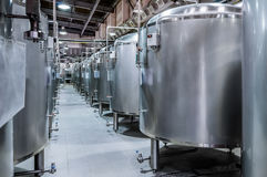 Modern Beer Factory. Small steel tanks for fermentation of beer. Modern Beer Factory. Small steel tanks for storage and fermentation of beer. Toned image Royalty Free Stock Images