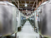 Modern Beer Factory. Steel tanks for beer fermentation. And storage. Motion blur effect Stock Photo