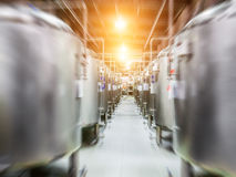 Modern Beer Factory. Steel tanks for beer fermentation. And storage. Motion blur effect, sunlight Royalty Free Stock Images