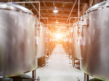 Modern Beer Factory. Steel tanks for beer fermentation. And storage. Sunlight effect Royalty Free Stock Photo
