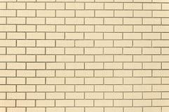 Modern beige brick wall background texture. Close up Stock Photos