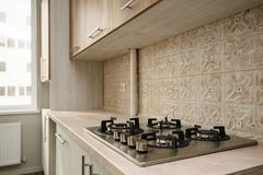 Modern beige kitchen Stock Images