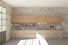 Modern beige kithen in brick loft interior royalty free stock photography