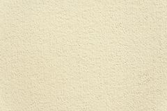 Modern beige painted wall background texture. Close up Stock Photos
