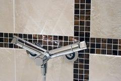modern belagd med tegel vägg för vattenkran royaltyfri bild