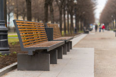 Modern bench in an alley in moscow city Stock Photos