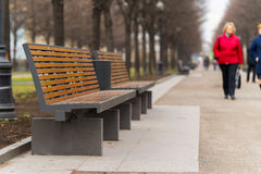 Modern bench in an alley in moscow city Royalty Free Stock Photo