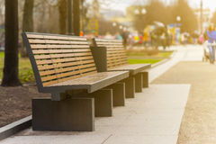 modern bench in an alley in moscow city. Royalty Free Stock Image