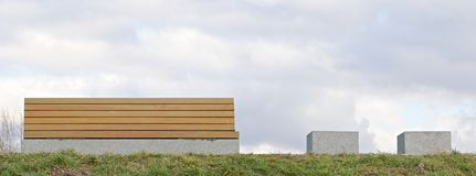 Modern bench on the grass Royalty Free Stock Image