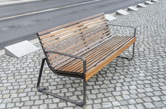 Modern bench on the pavement. Stock Image