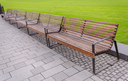 Modern bench on the pavement. Royalty Free Stock Image