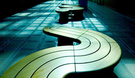 Modern benches. Horizontal row of modern benches in blue hall interior, Japan Royalty Free Stock Photos