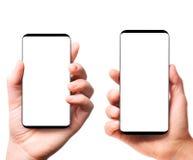 Modern bezelless smartphones in hands Stock Images