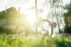 Modern bicycle in European City with sunlight sun-flare behind Stock Photography