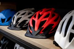 Modern bicycle helmets for family or group of people royalty free stock photography