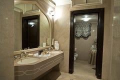 Modern biege bathroom. Simple modern bathroom with sinks Royalty Free Stock Image