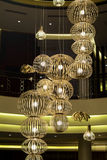 Modern big  chandelier in a luxury hotel  lobby. Huge chandelier in a luxury hotel lobby,Bodrum,Turkey Royalty Free Stock Images