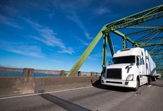 Big rig white semi truck with dry van trailer transporting comme Stock Image