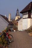 Modern bike in old German town Stock Photos