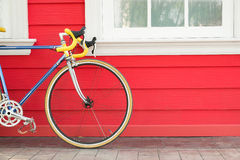 Modern bike stand near wooden wall Stock Photography