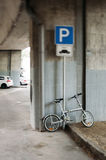 Modern bike in urban parking Royalty Free Stock Photography
