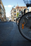Modern bike wheels contrast with old cobblestones Royalty Free Stock Photo
