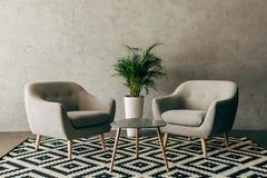 modern binnenland met uitstekend meubilair in zolderstijl met concrete muur royalty-vrije stock afbeelding