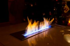 Modern bio fireplace in the marble slab Royalty Free Stock Images