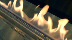 Modern bio fireplot on ethanol gas close-up. Biofireplace burn on ethanol gas. Contemporary mount biofuel on ethanol fireplot fireplace close-up. Modern stock footage