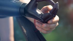 Modern bionic prosthesis, close up. Futuristic concept. One person wears a black artificial hand