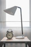 Modern black alarm clock with modern white lamp Stock Photo