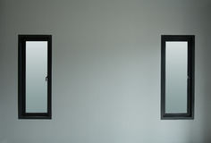 Modern black aluminium window with gray wall Royalty Free Stock Images