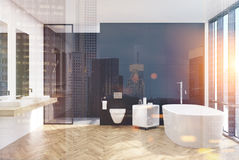 Modern black bathroom interior, lavatory, night. Modern black bathroom interior with a loft window, a lavatory, white tub, two sinks and a shower. 3d rendering Stock Photos