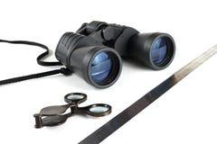 Modern black binoculars. Types of the binoculars in different foreshortenings Stock Image