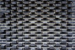Modern black brick wall texture. Modern black brick wall pattern and texture. Architectural background Stock Photography
