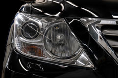 Modern black car headlights. Royalty Free Stock Images