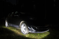 Modern black car illuminated from underneath in night. Arrival o Royalty Free Stock Photo
