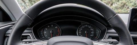 Modern black car instrument panel Stock Photos