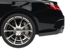 Modern black car - rear wheel closeup shot Stock Photography
