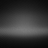 Modern black carbon fiber for background. Modern background with distorted black carbon fiber smooth on surface Royalty Free Stock Photo