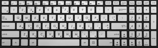 Modern black and chrome laptop keyboard Royalty Free Stock Images