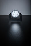 Modern black clock on black table in the office Stock Photos