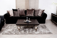 Modern black coloured fabric couch Stock Photography