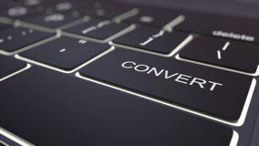 Modern black computer keyboard and luminous convert key. 3D rendering Royalty Free Stock Image