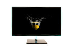 Modern black computer monitor with motion splash Stock Photos
