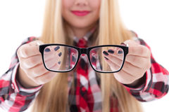Modern black eyeglasses in female hands Stock Photography