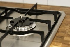 Modern black gas stove close-up, top view. A Modern black gas stove close up, top view, side view stock photography